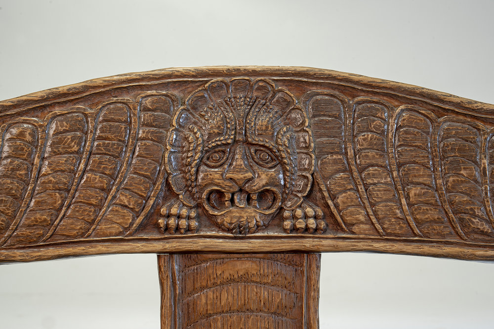 Figure 19: Bryn Athyn Cathedral Tyldal-style chair depicting a lion's head on the crest rail.
