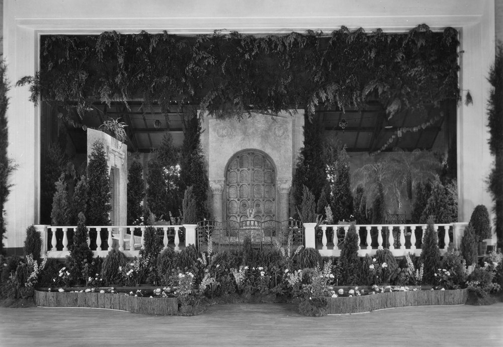 Figure 5: Glencairn's massive bronze door provides a focal point for the Assembly Hall stage where the wedding party greeted their guests.