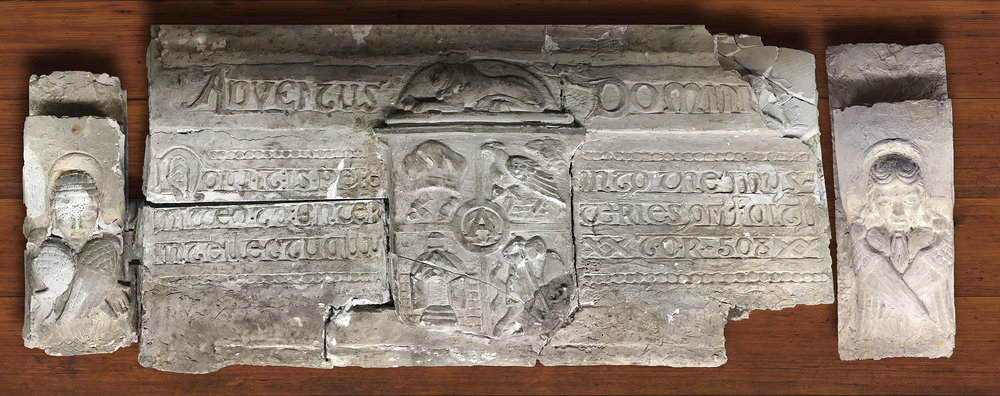 Figure 15: A plaster model for the lintel above Glencairn's chapel door depicting the seal for the Academy of the New Church, a pair of angels, and a quotation from Emanuel Swedenborg. It was probably cut from the larger plaster model used at the wedding reception in 1934. It has been preserved in Glencairn's collection of architectural models.
