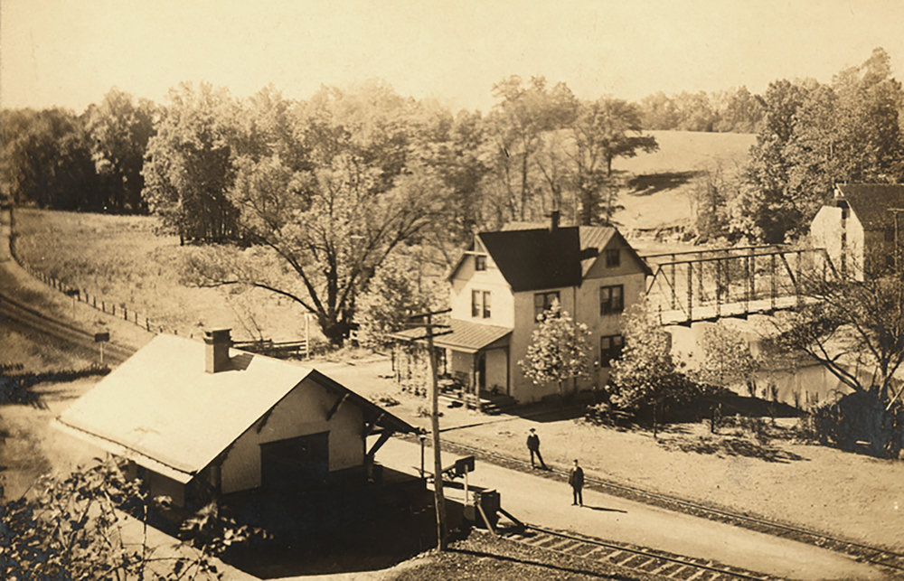 Figure 5: This photograph (circa 1902) shows both the old Alnwick Grove train station (right) and the new Bryn Athyn station (left). A small portion of Alnwick Grove park can be seen in this photo (upper left). Photo: Academy of the New Church Archives.