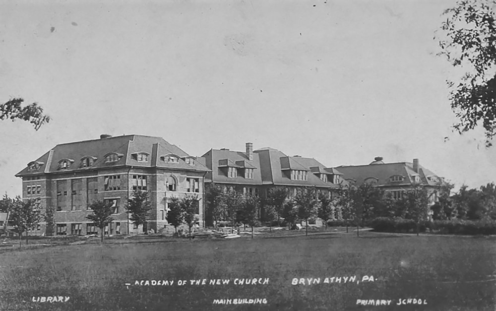 Figure 8: This postcard of the Academy of the New Church campus, postmarked October 9, 1919, shows (from left to right) the library and museum, Benade Hall (the classroom building), and De Charms Hall (the elementary school).