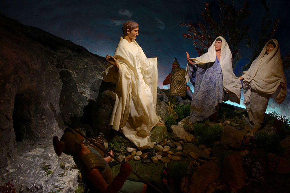 "Figure 6: Mary Magdalene and ""the other Mary"" come to visit Christ's tomb on Sunday morning and are met by an angel. This scene is part of the Winfred Hyatt Easter scenes designed for the Pitcairn family in the 1920s."