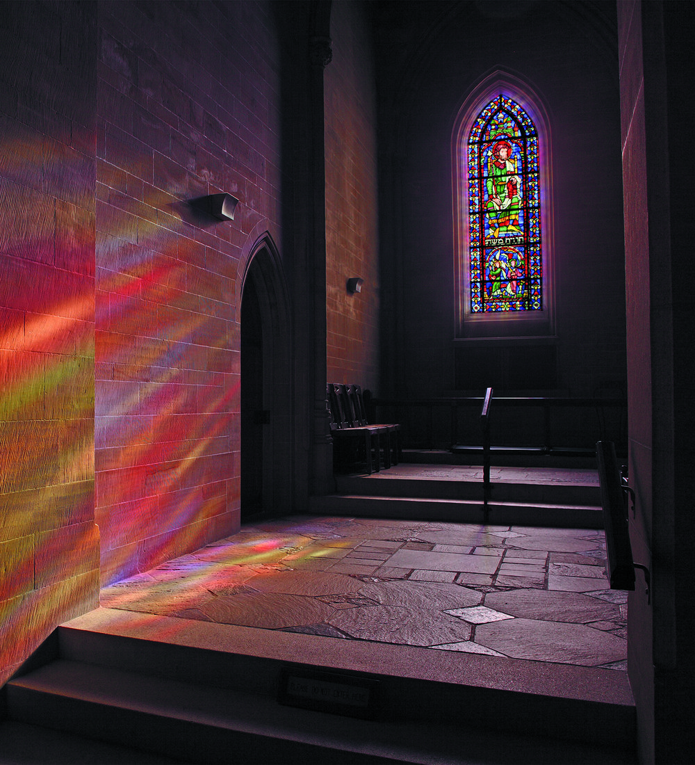 Light streams through the north chancel aisle window in Bryn Athyn Cathedral, bathing the sandstone wall in a rainbow of colors. Photograph courtesy of Hal Conroy.