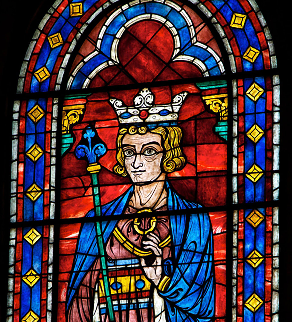 Figure 1: This reproduction of a stained glass window in Chartres Cathedral, which depicts King Solomon, is located in the center of the north wall of Glencairn's Great Hall. It was made in the Bryn Athyn glass factory and studio.