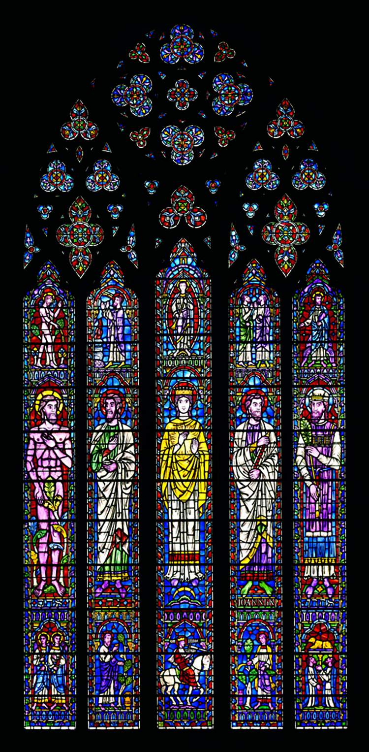 Figure 2: This window was made in the Bryn Athyn stained glass factory and studio for the west portal of Bryn Athyn Cathedral. From left to right, the biblical characters represented in the center panels are Adam, Noah, the Woman Clothed with the Sun (Book of Revelation 12:1), John the Evangelist and Aaron. Photograph courtesy of Hal Conroy.