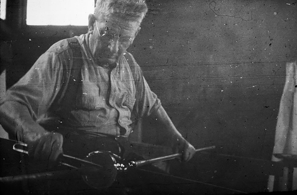 Figure 11: David Smith works at the glassblower's bench. He emigrated from Sweden to the United States as a young man and, after working for a time as a glassblower in New York, came to Bryn Athyn in July, 1922. Smith stayed on at the factory until it closed 20 years later. He was 78 years old when he blew his last batch of Bryn Athyn glass on April 10, 1942.