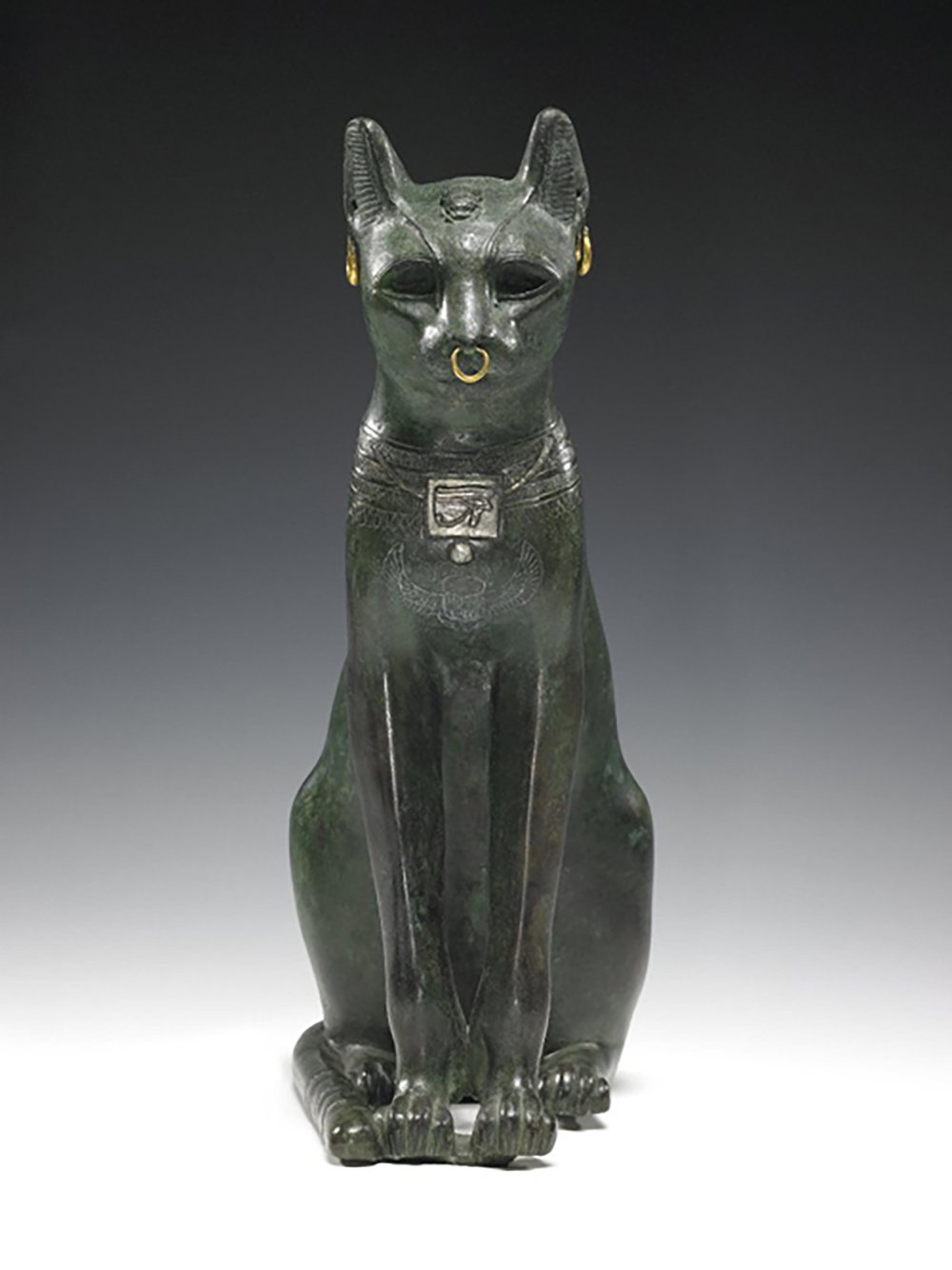 Figure 14: The bronze hollow-cast Gayer-Anderson cat figure with details in silver and gold, Late Period (664-332 BCE). British Museum EA64391. Image courstesy of the British Museum.