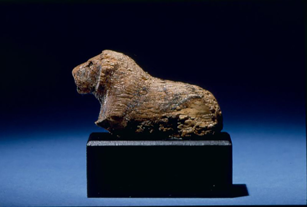 Figure 20: Ivory game piece in the form of a lion from Abydos, Egypt, Dynasty 1 (3000-2800 BCE). Penn Museum E11522.