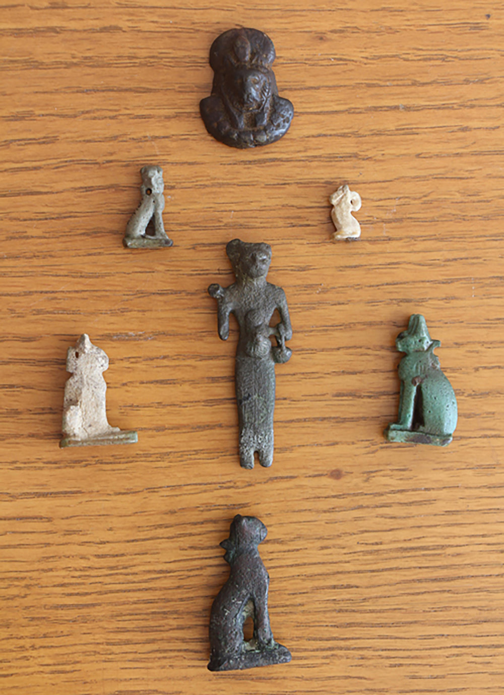 Figure 24: An assortment of feline and leonine amulets in the Glencairn collection.