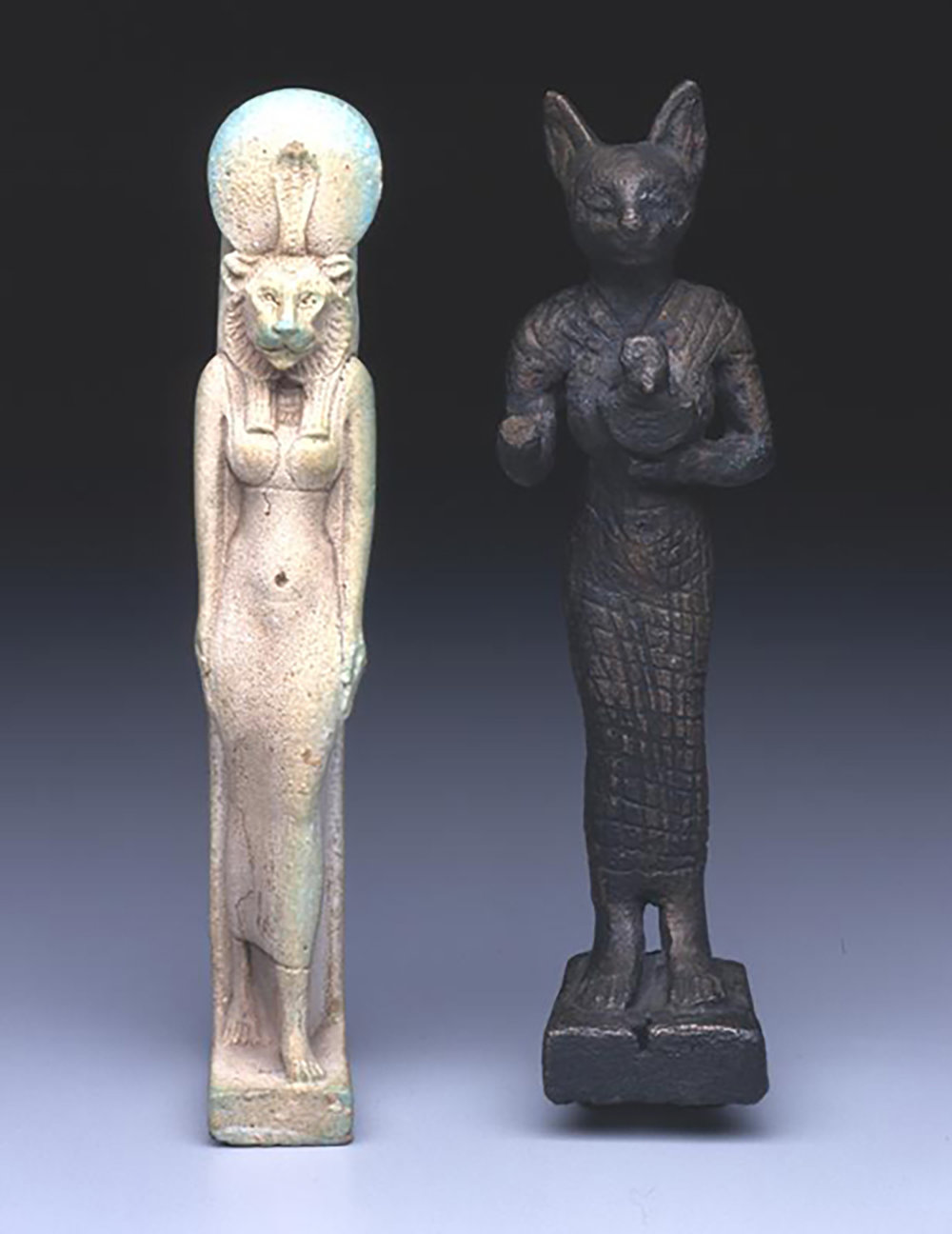 Figure 25: A faience amulet of Sekhmet, post Third Intermediate Period (after 656 BCE) and a bronze votive statuette of Bastet, Late Period (664-332 BCE). Penn Museum E14357 and 29-70-695.