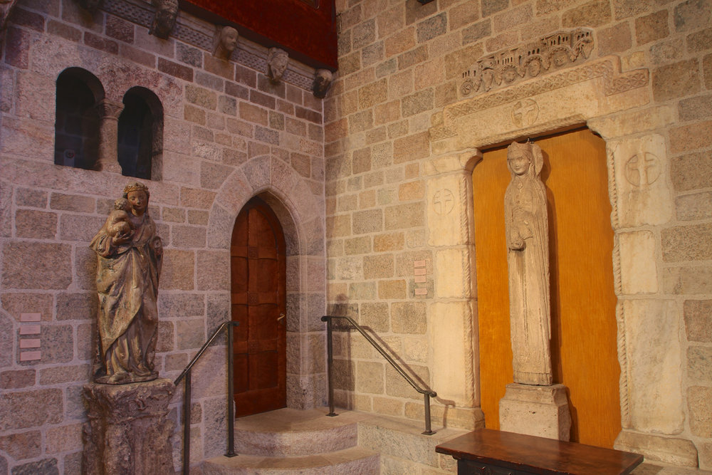 "Figure 8: Raymond Pitcairn installed the ""Slim Princess"" in the southeast corner of Glencairn's great hall, together with other sculptures dating to the medieval period."