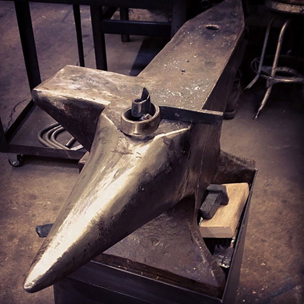 Figure 2: An anvil at Warren Holzman's Iron Studio with a piece of metalwork. Photograph by Warren Holzman.
