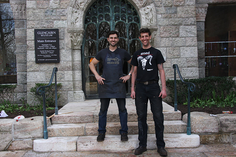 Figure 23: Warren Holzman (right) and Mike Rossi, a fellow metalworker, pose in front of the newly-installed railings at Glencairn's main entrance.