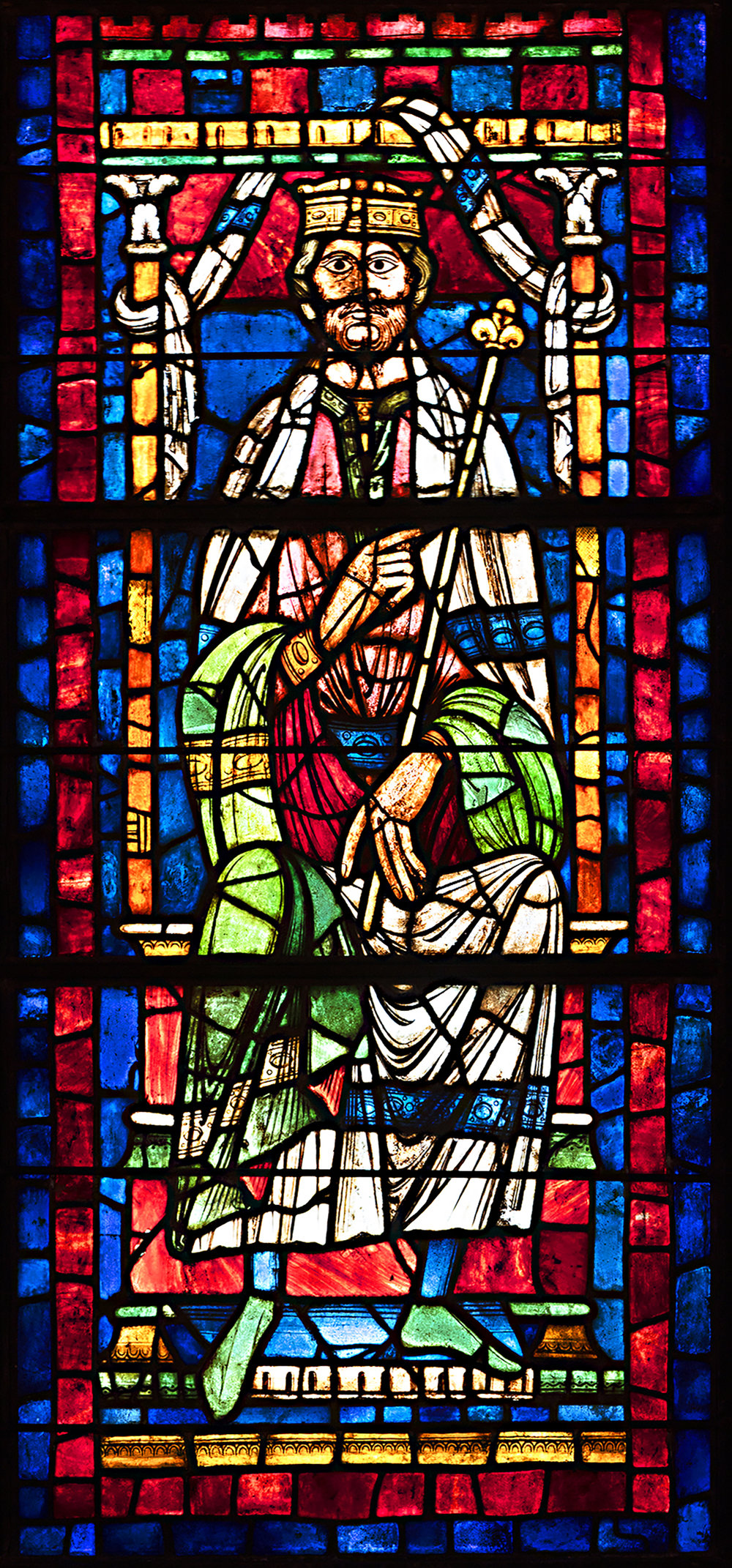 Figure 1: Seated King, stained-glass panel from the Church of Saint-Yved, Braine, France, c. 1190-1200 (03.SG.234).