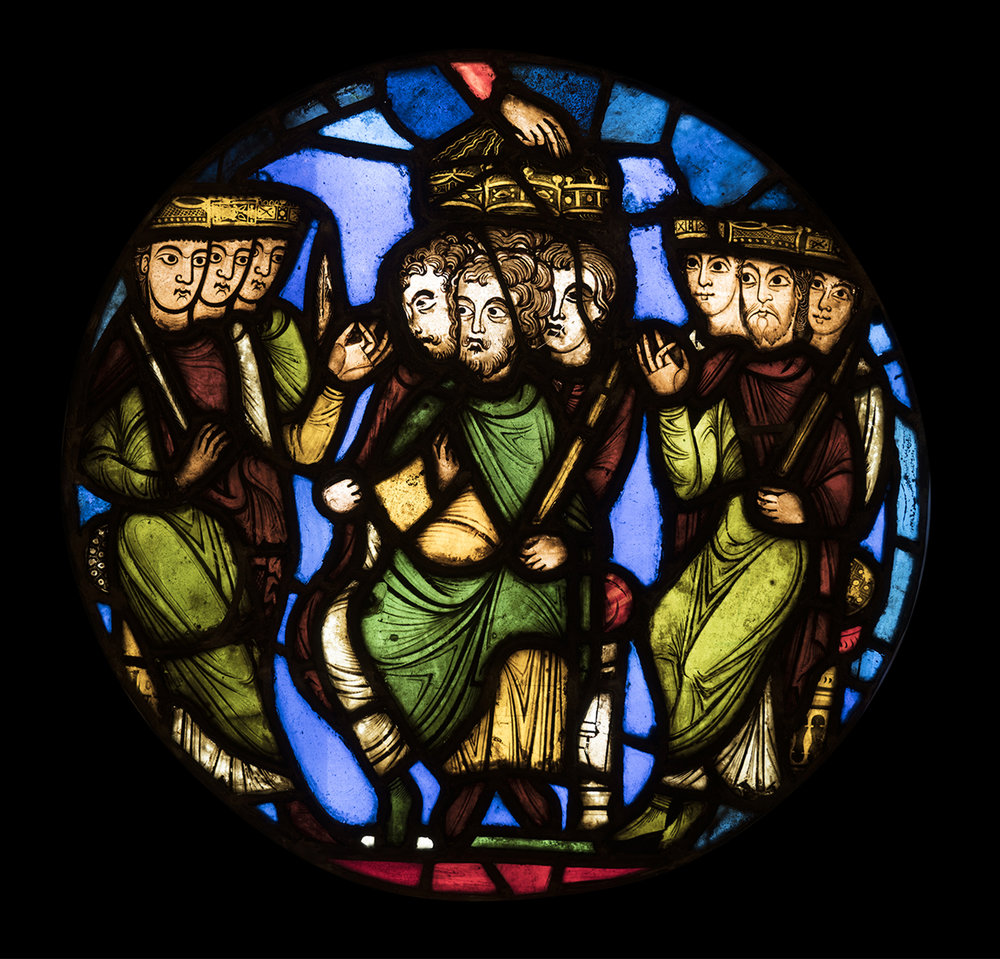 Figure 9: A Coronation Scene, stained-glass panel from the Royal Abbey Church of Saint-Denis, outside Paris, France, c. 1150. The Hand of God in the center crowns three kings (03.SG.111).
