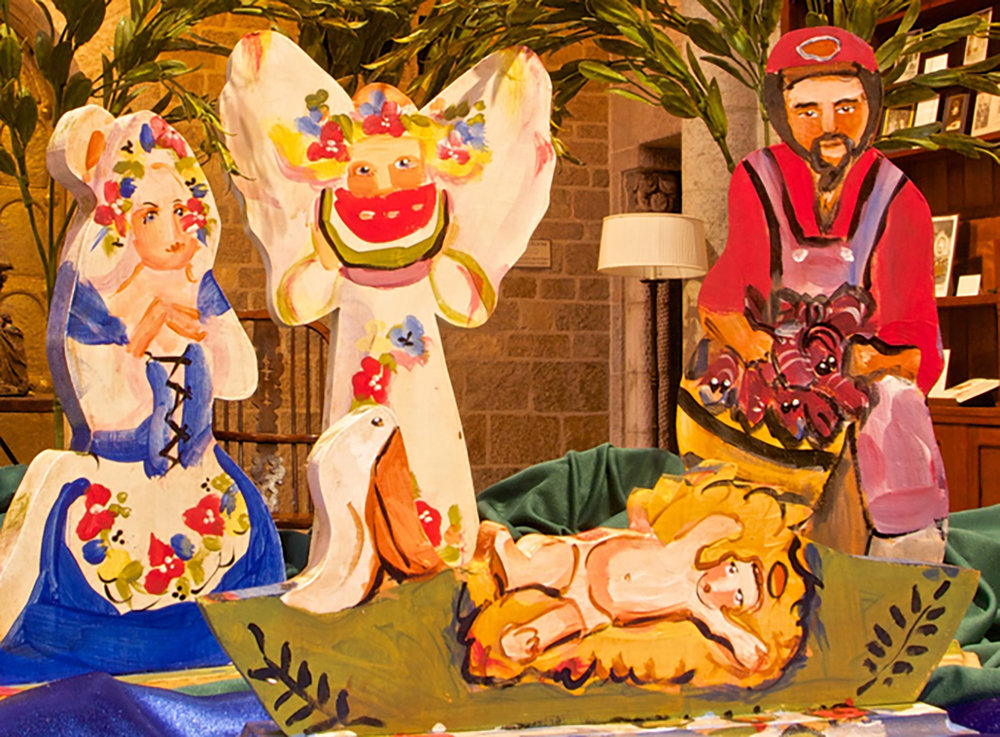Figure 10: The Cajun Nativity features the baby Jesus in a  pirogue  (a bayou canoe), with Mary in traditional Acadian dress and Joseph holding crawfish.