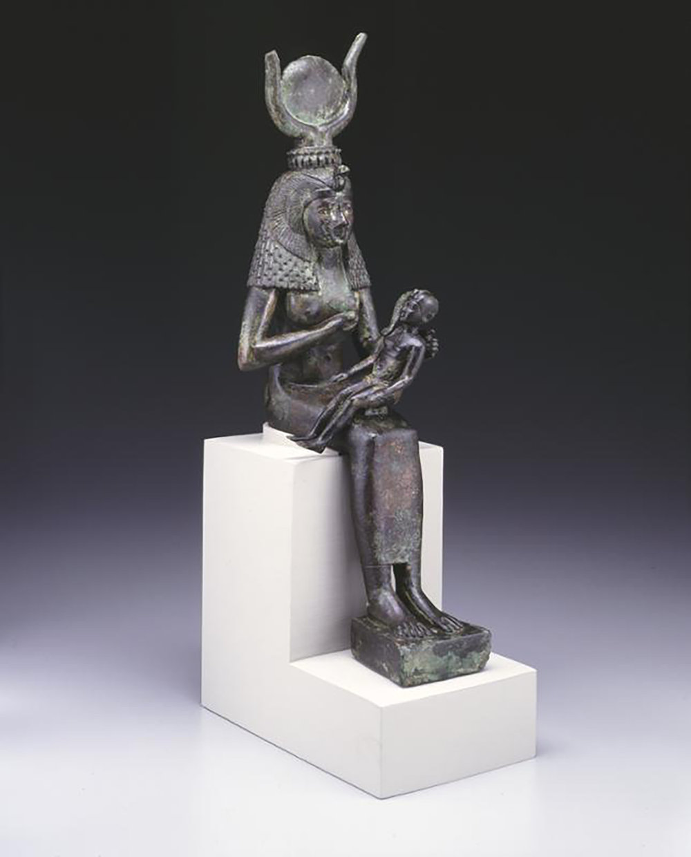 Figure 1: Bronze statuette of the goddess Isis nursing the infant Horus. Late Period (664-332 BCE). University of Pennsylvania Museum E12548.