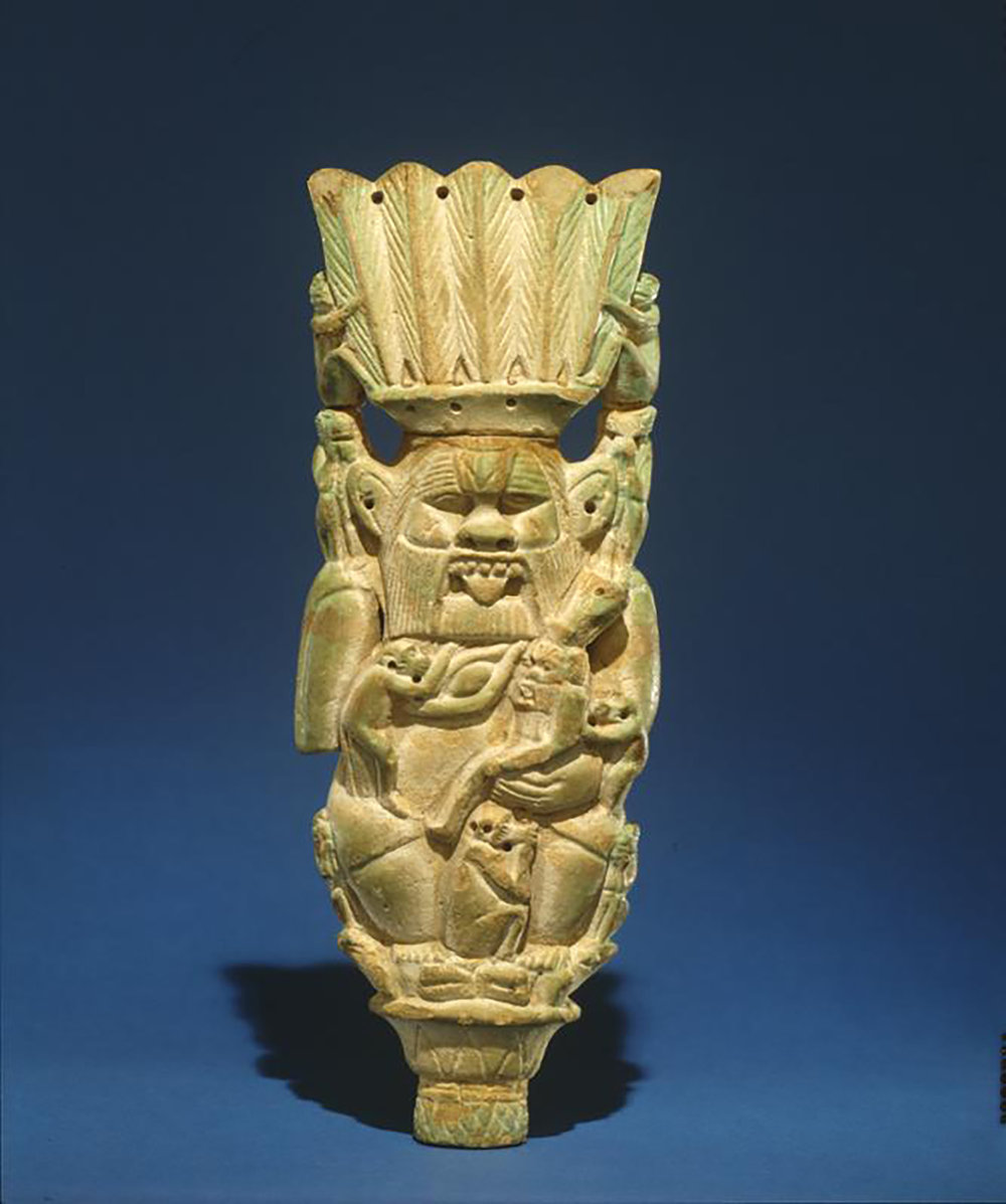 Figure 11: Faience plaque of the god Bes. Dynasty 21-25 (1075-656 BCE). University of Pennsylvania Museum E14358.