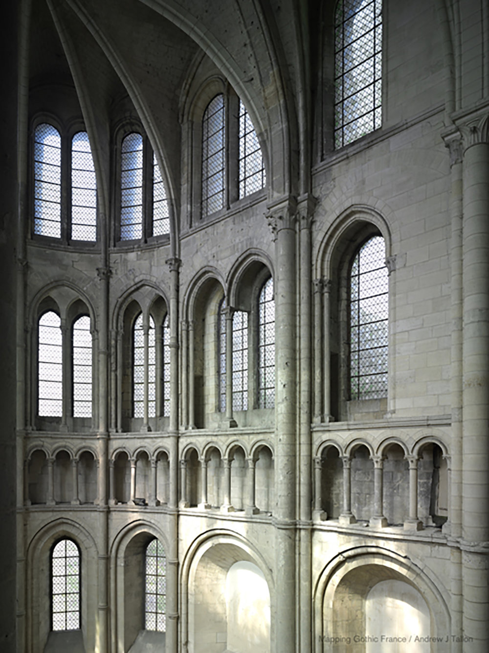 Figure 3: Noyon, Cathedral of Notre-Dame: view of the north transept. The rounded termination of the transept and inversion of the conventional levels of triforium and tribune are hallmarks of this age of experimentation.