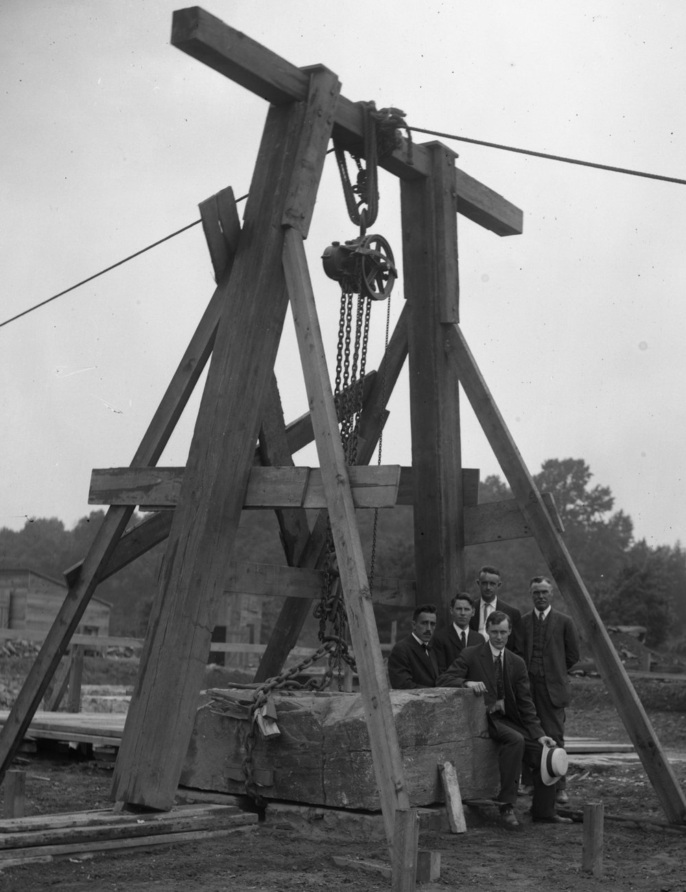 Figure 3: A large stationary frame was constructed with a block and tackle to lower the seven-ton cornerstone during the ceremony. Pictured from left to right are (first row) Raymond Pitcairn; (second row) Edwin T. Asplundh, Robert Tappan, Albert C. Perry, and Pringle Borthwick.