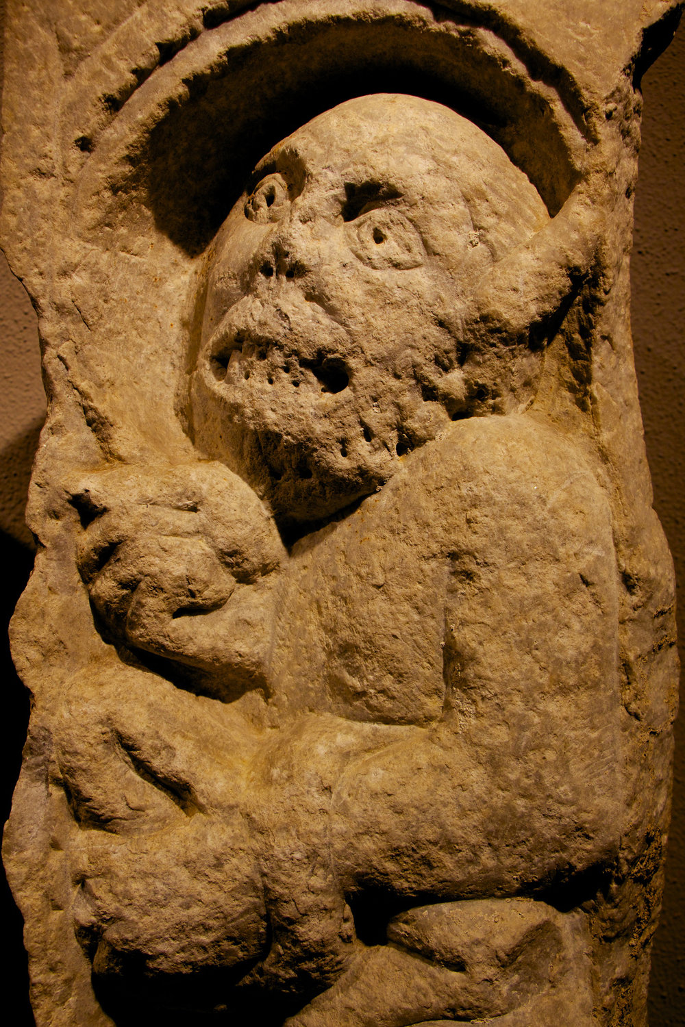 Figure 3: The devil holds a stone in his left hand with his tail draped over his arm.