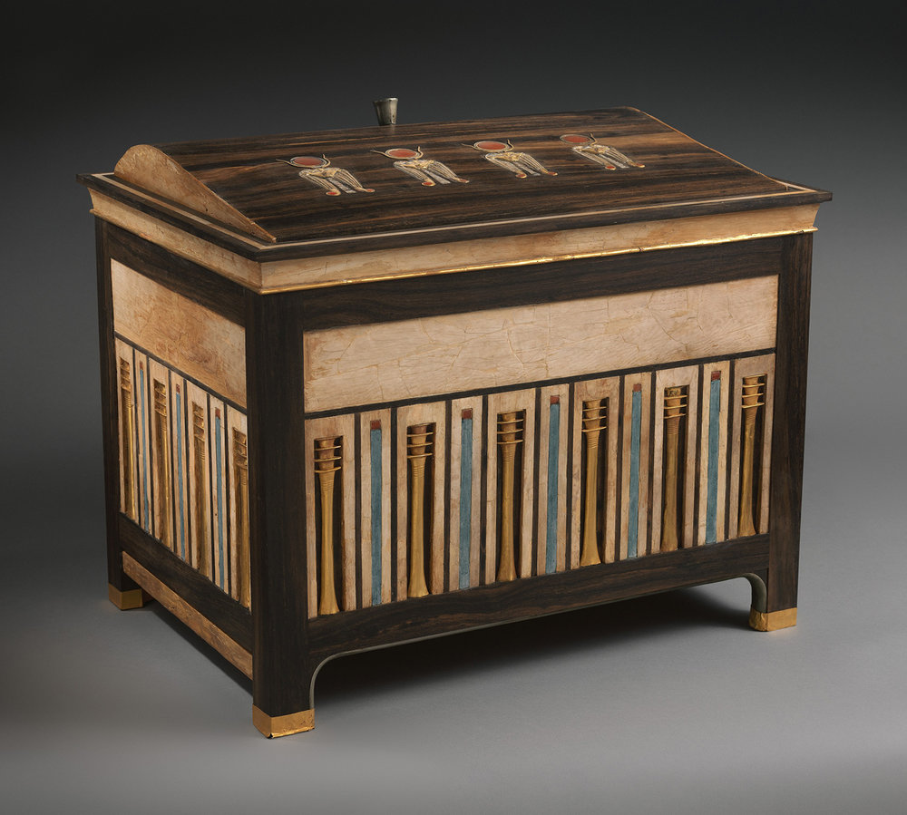 Figure 7: Jewelry Chest of Sithathoryunet, Purchase, Rogers Fund and Henry Walters Gift, 1916, Metropolitan Museum of Art, 16.1.1. Image courtesy of The Metropolitan Museum of Art, NYC. This wooden jewelry chest combines Hathoric imagery on its lid and elongated  djed  pillars along the sides. These decorations, while aesthetically pleasing, also had deeper religious meaning.