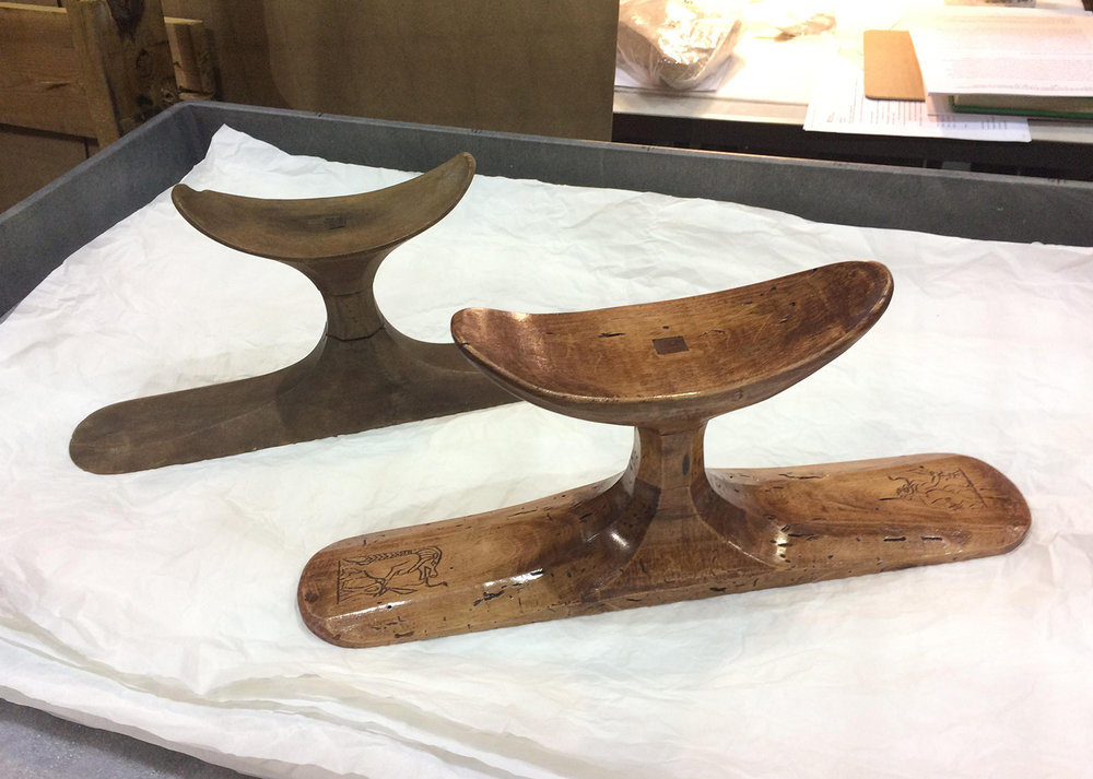 Figure 20: The finished replica headrest (in front) beside the original (UPMAA 29-86-400a, b).