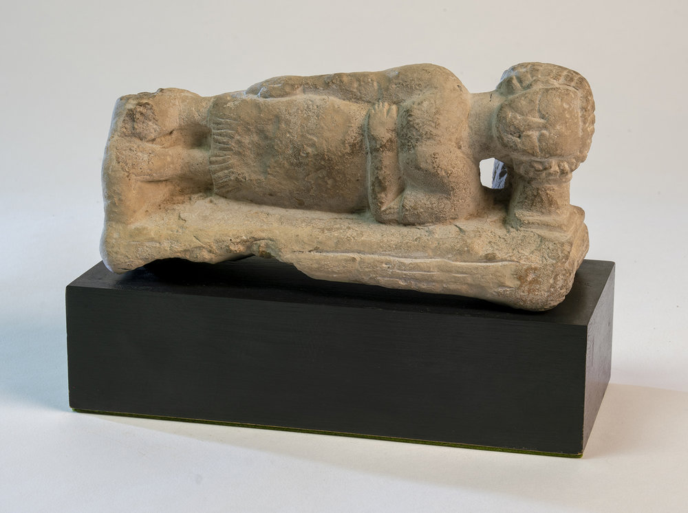 Figure 15: Limestone figure of a woman sleeping on her left side, her head supported by a headrest. In the collection of Glencairn Museum (E1219).