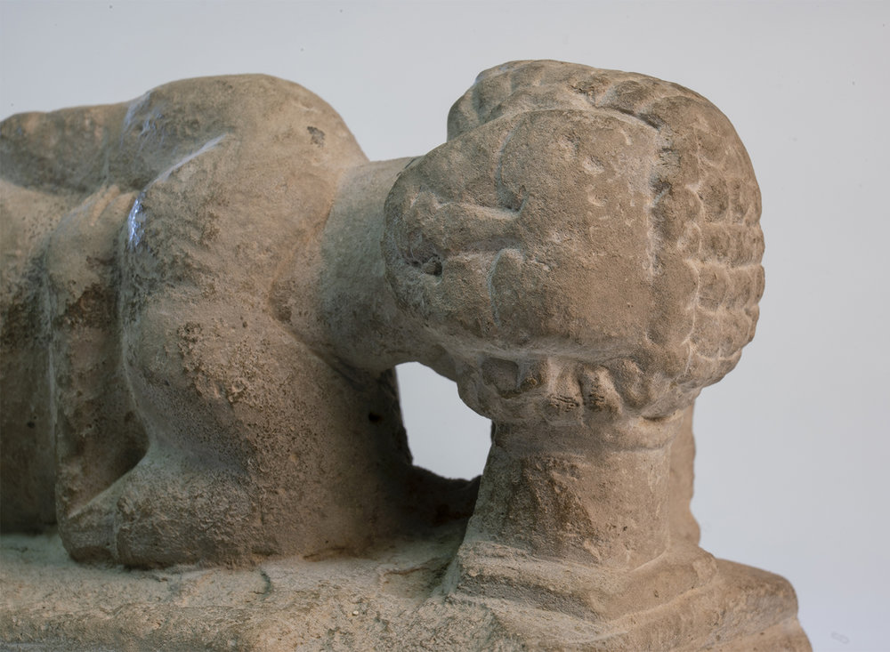 Figure 16: Closeup of the headrest on Glencairn's limestone figure (E1219).