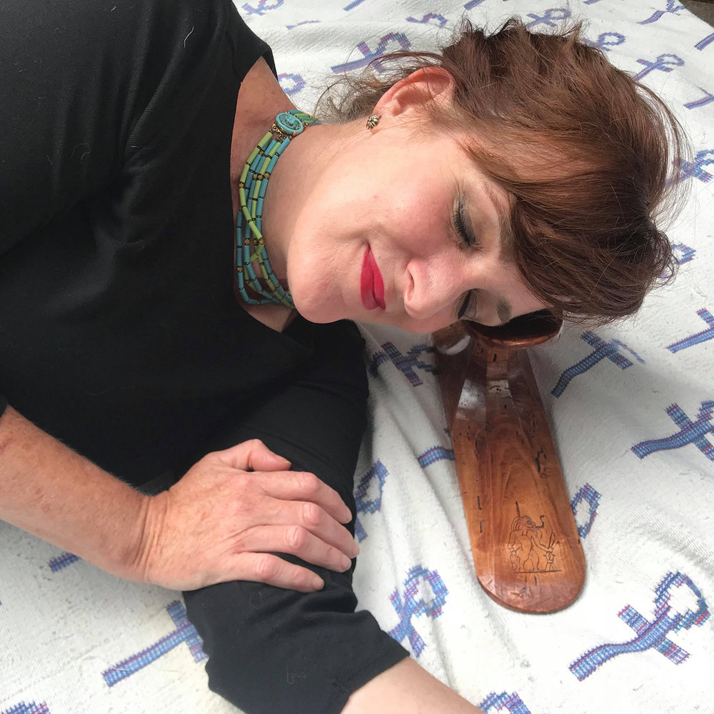 Figure 22: The author lying on her side, using the reproduction headrest.