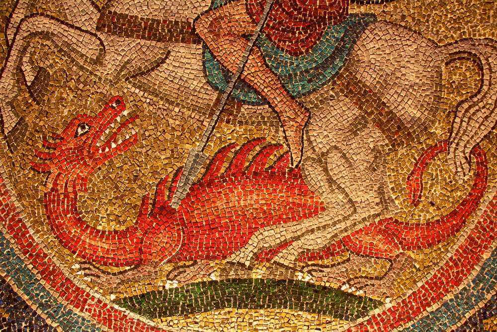 Detail of a mosaic dragon from Glencairn's Great Hall archway.
