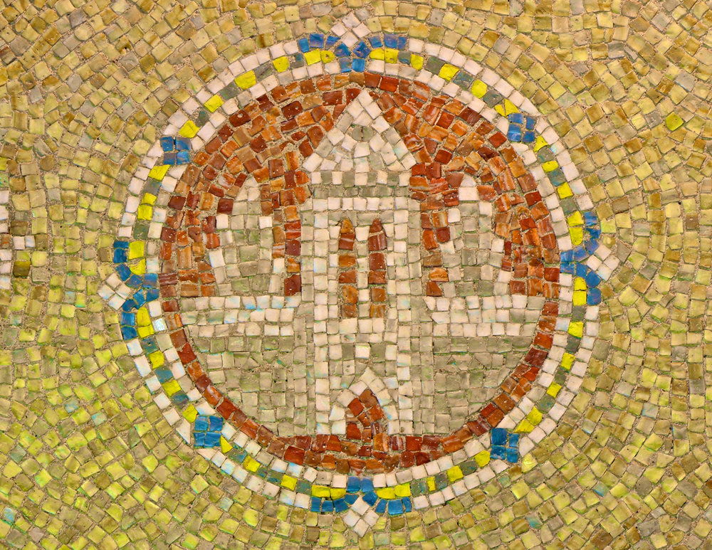 Figure 1: Mosaic medallion on the wall of the first floor entryway area.