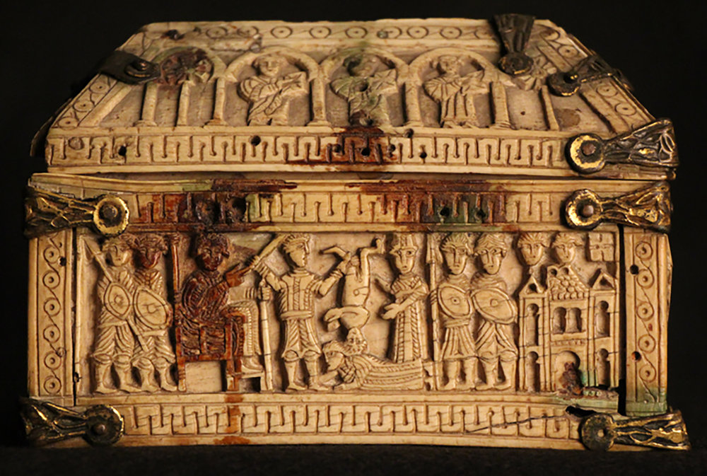 Figure 3: Scene on one of the long sides of the box depicting the Judgment of Solomon from 1 Kings 3:16-28.