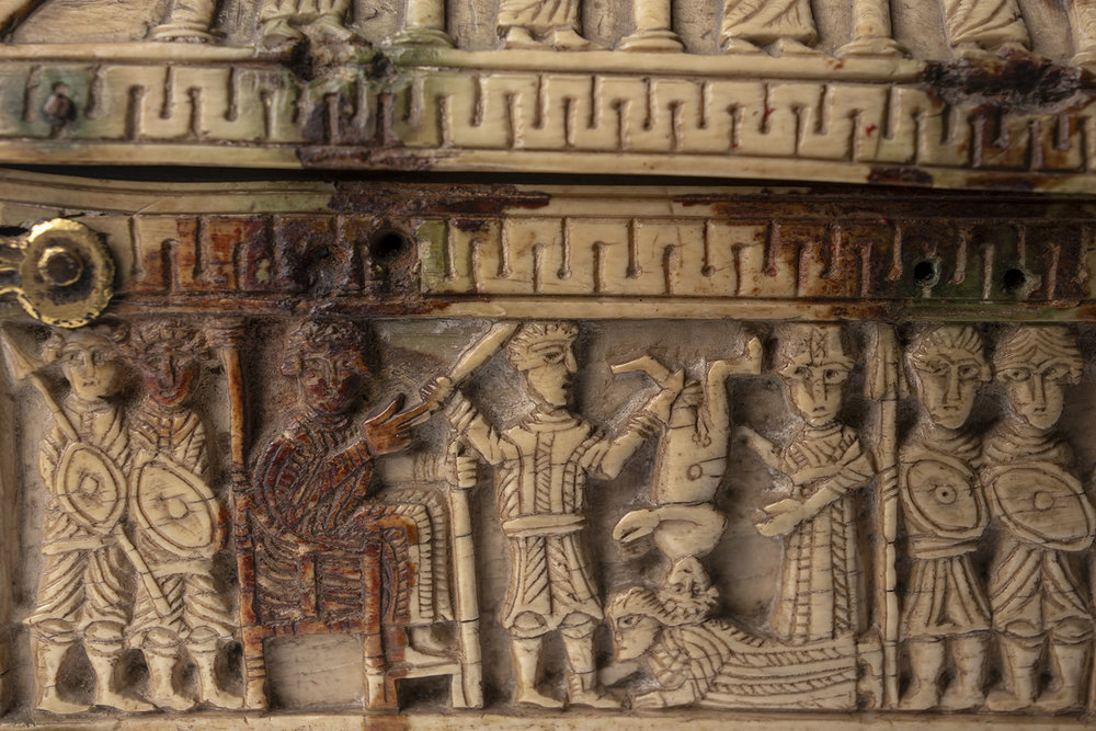 Figure 7: Detail from the Judgment of Solomon showing the carving style of the figures, with deeply-cut eyes.