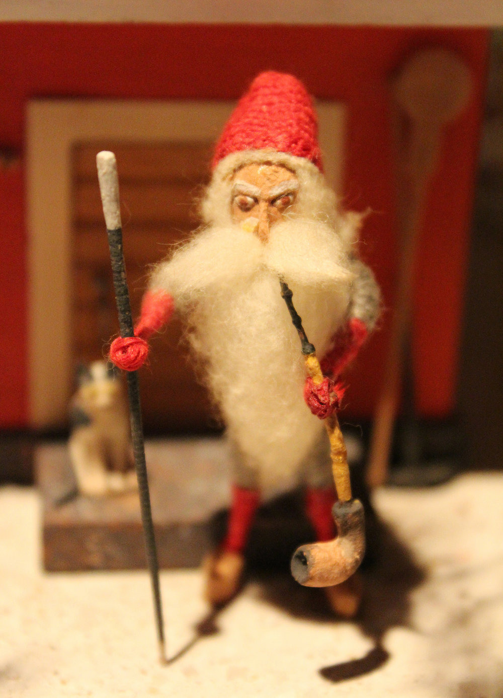 Figure 1:  Tomte  with a walking stick smoking his pipe.