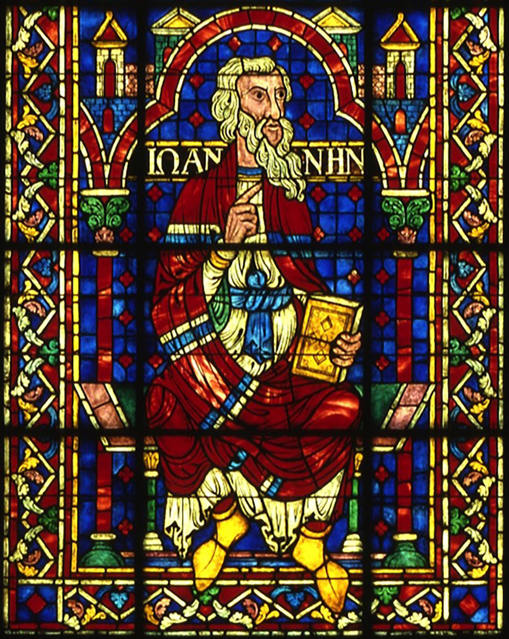 Figure 5: John beneath the Angel with Censer window in Glencairn's Great Hall.