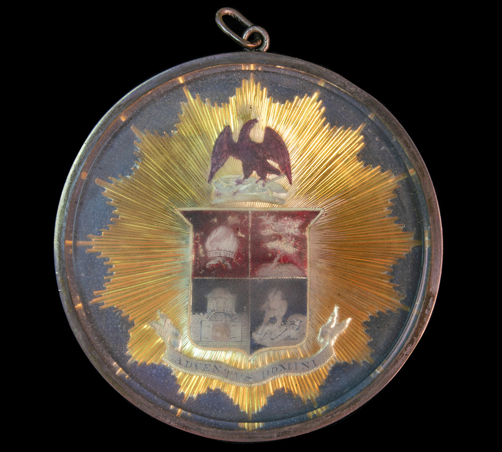 Figure 7: The first medallion produced by the Academy featured an eagle above the shield. This would later be replaced by a lion.