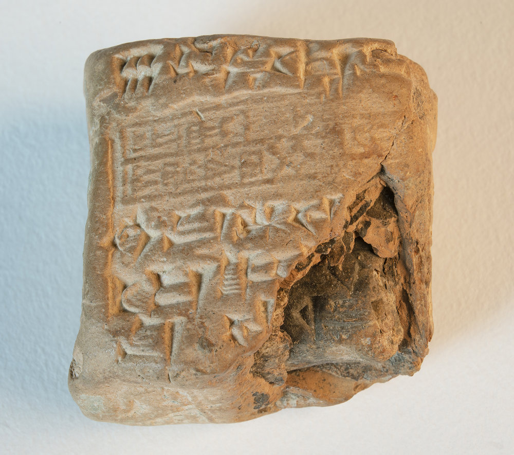 Figure 10: Cuneiform tablet in unopened envelope; receipt for six copper hoes. Terracotta, Ur III, circa 2046 BCE. In Glencairn's Ancient Near East gallery (01.IS.48).