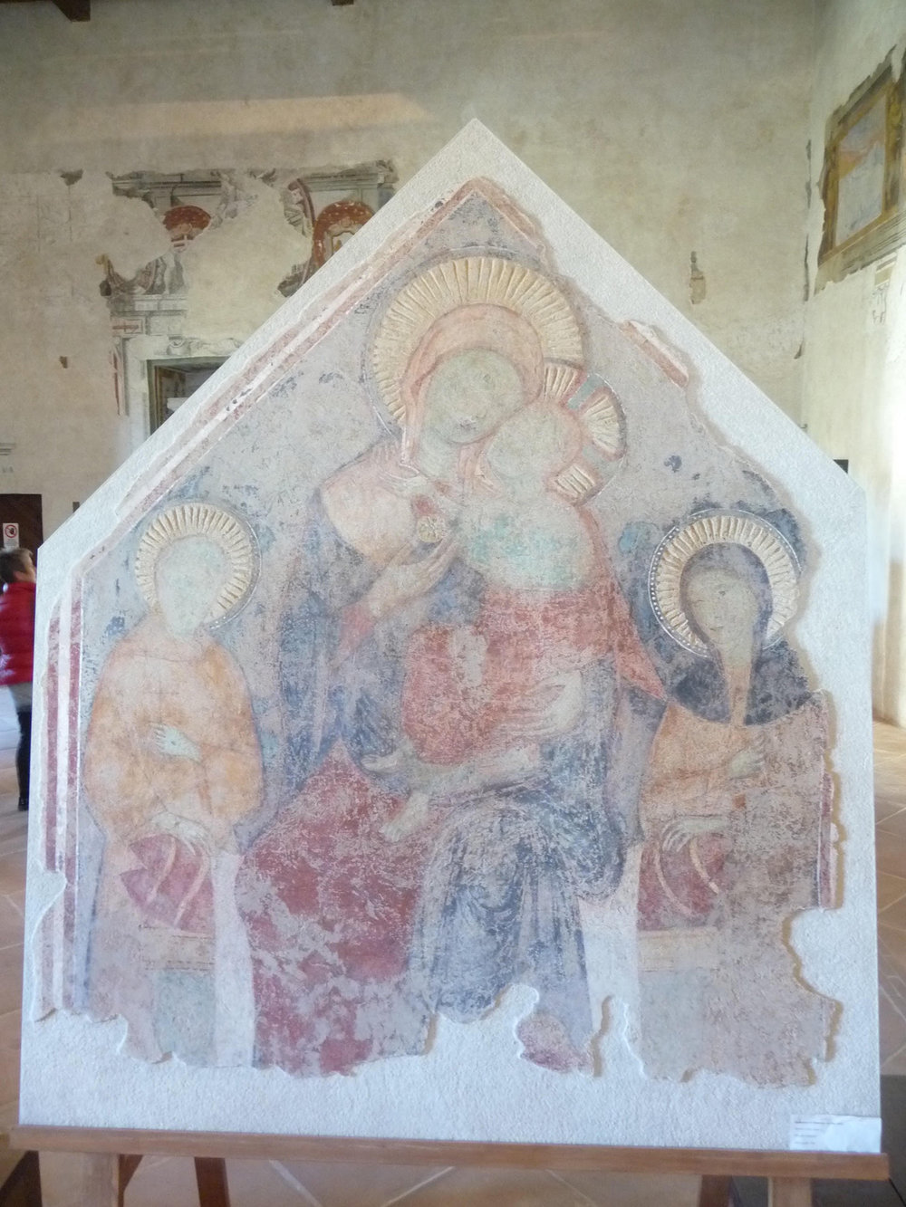 Figure 10.  Madonna and Child with Saints Francis and Claire , detached fresco by an unknown artist, c. 1300, originally from the Clarissan monastery of Santa Maria inter Angelos, near Spoleto, Italy. Now in the Museo Nazionale del Ducato, Spoleto. Photograph by Jonathan Kline.