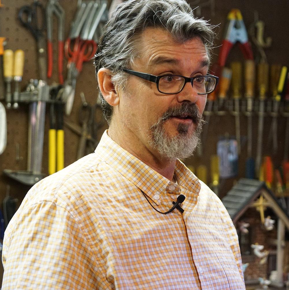 Figure 1: R. Michael Palan being interviewed in his basement workshop.