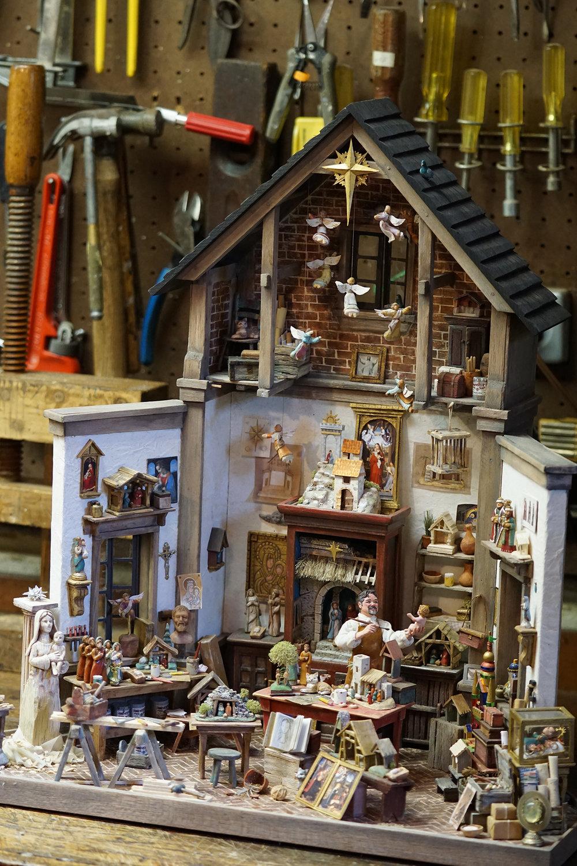 Figure 3: R. Michael Palan's  Nativity Maker's Workshop  on the workbench in his basement workshop.
