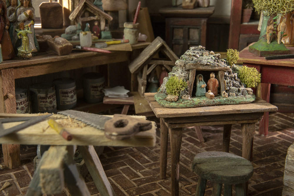 Figure 8: On the table is a scene representing the Grotto of the Nativity, a cave where some believe Jesus was born.