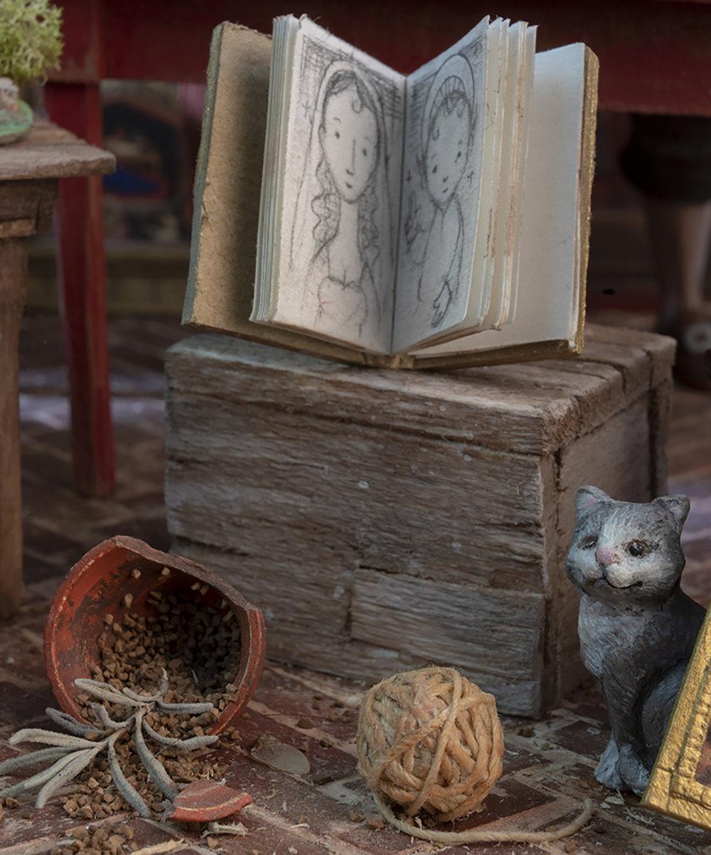 Figure 17: A cat, a ball of string, and a broken flower pot.