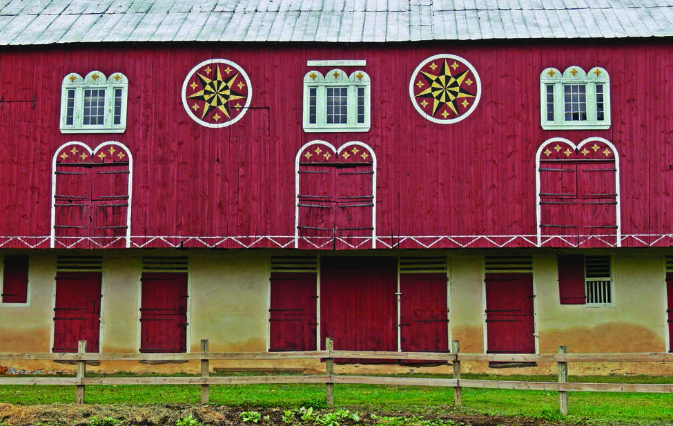 Figure 14: The Barn at Grim Manor, Maxatawny Township, Berks County. Courtesy of Patrick J. Donmoyer. A classic Berks County arrangement of stars, painted trim, and decorative borders. Although the stars are not locally believed to serve a protective function, the three crosses above windows and doorways are not merely a decorative scheme, but a blessing of the structure.