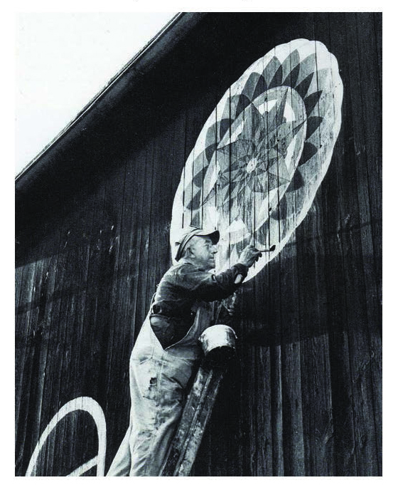 Figure 36: The barn star artist Milton J. Hill (1887-1972) of Virginville, painting his classic star pattern on a barn in Berks County, ca. 1950. Courtesy of the Pennsylvania Folklife Society Archive, Myrin Library, Ursinus College.