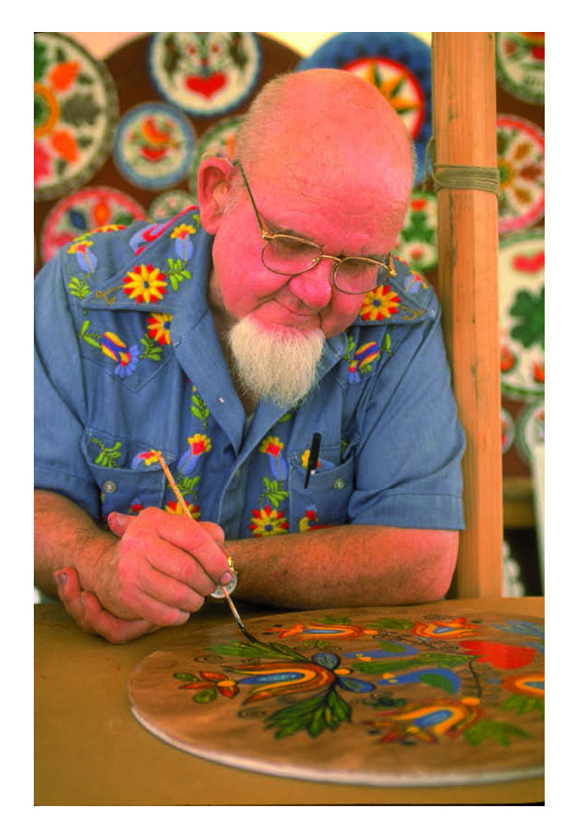 "Figure 45: Artist Johnny Claypoole (1921-2004) of Lenhartsville, who learned his technique from the legendary ""Professor of Hexology"" Johnny Ott (1890-1964), owner of the Lenhartsville Hotel and the progenitor of the commercial hex sign art of the 1950s and 60s. Claypoole painted commercial hex sign disks like his mentor, but unlike Ott, he also painted dozens of historic barns with stars in the region. Courtesy of the Pennsylvania German Cultural Heritage Center, Kutztown University."