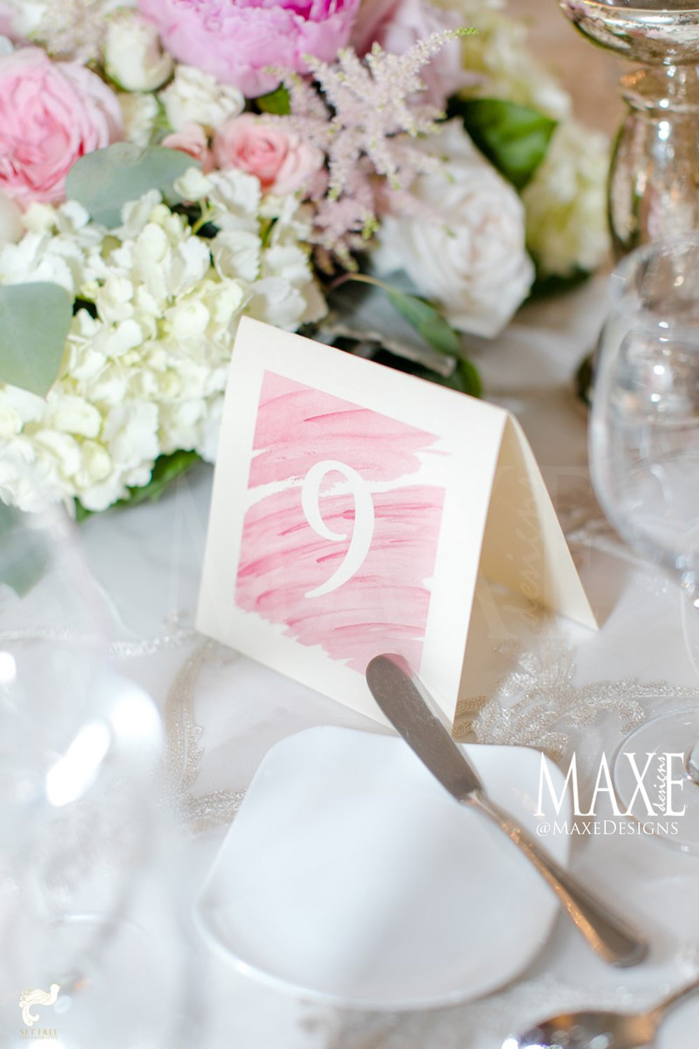 Amanda & Alex's Florida Wedding - a beautiful watercolor was the perfect complement to their table décor.
