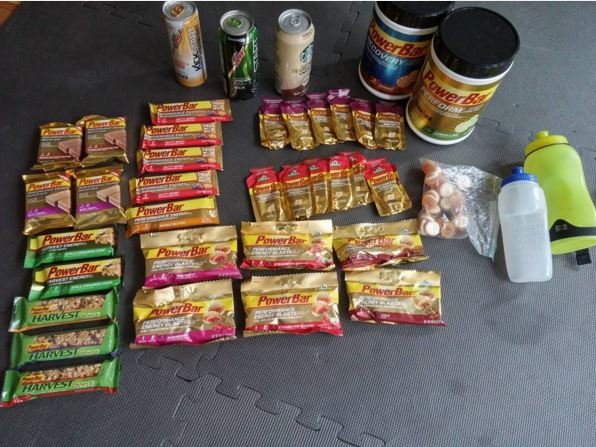 pile of powerbar products that i brought to the jfk 50 miler in 2015