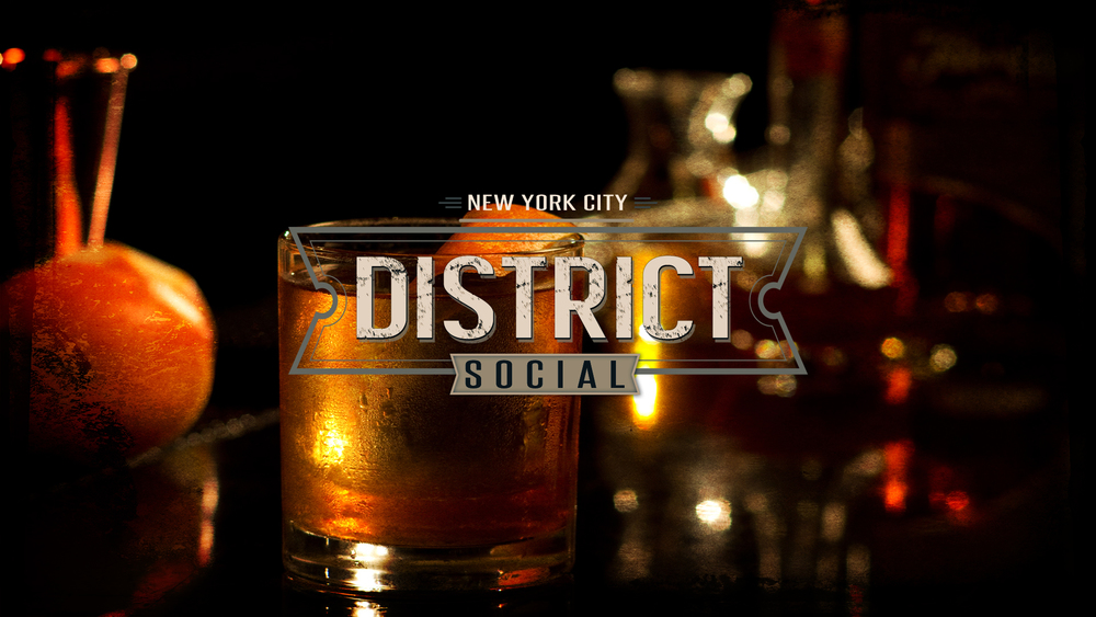 District Social Logo Over Old Fashioned Cocktail