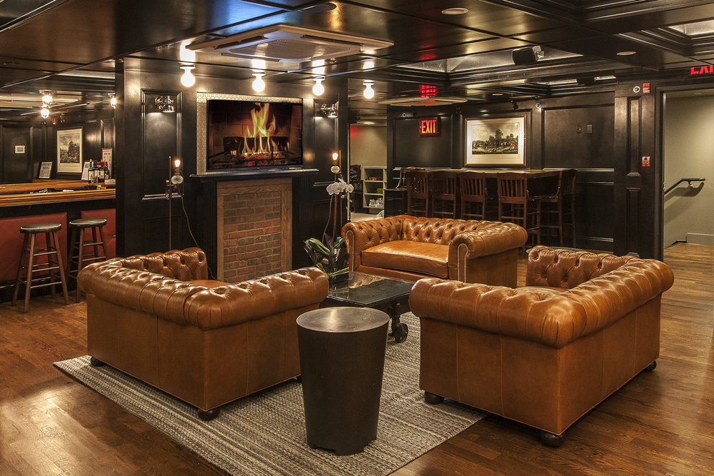 Three Leather Couches Create Lounge Area